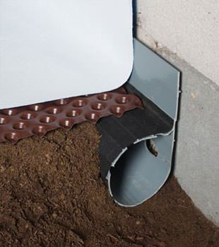 Closeup of a crawl space drainage system installed in Aldie
